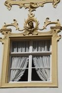 Baroque window with clay modelling