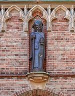 statue on the facade of a church in the Netherlands