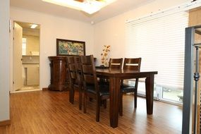 Wooden dining table in a family house