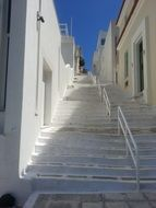 staircase among white houses in greece