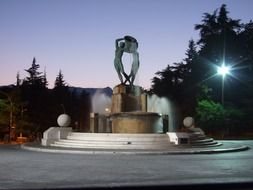 fountain with sculpture at dusk, italy, l'aquila