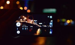 Making a photo by mobile of night city
