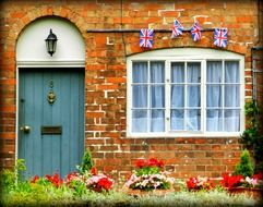 British flags on the facade of an English cottage