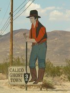 a man with a shield in a ghost town, California