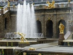 Golden statues near fountains in Petersburg
