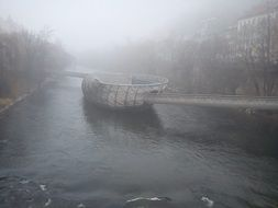 blurred photo of a boat on a river