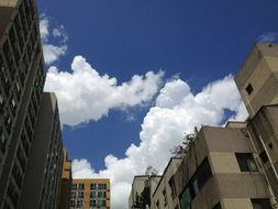 white clouds over buildings