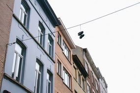 shoes hanging on wires