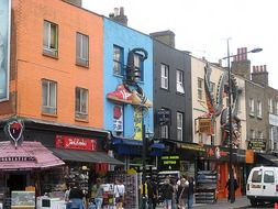 colorful facades of houses on a shopping street in London