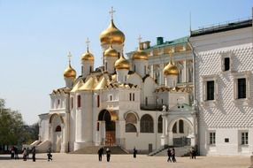 white orthodox cathedral with golden domes