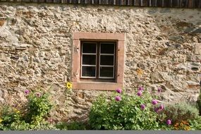 Small window on the stone wall