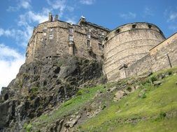 Edinburgh Castle is a historic fortress on the hill