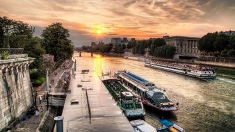 Boats on the seine river in Paris at sunset