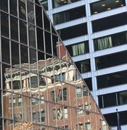 reflection of building on angle of glass facade