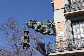 dragon sculpture on a wall in Barcelona