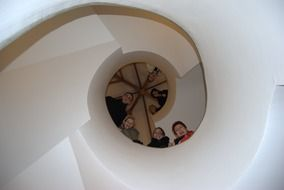 people on the spiral staircase