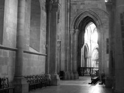 arched interior of a church in portugal in black-white