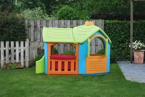 plastic playhouse on the yard