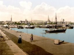 old photo of sailing ships in kingstown port at city, ireland, dublin