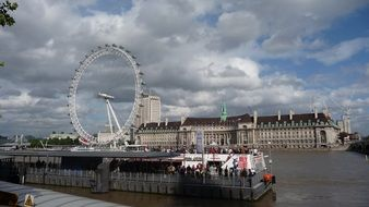 London ferris wheel view from the river Thames
