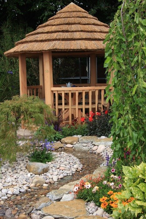 wooden gazebo on pebbles