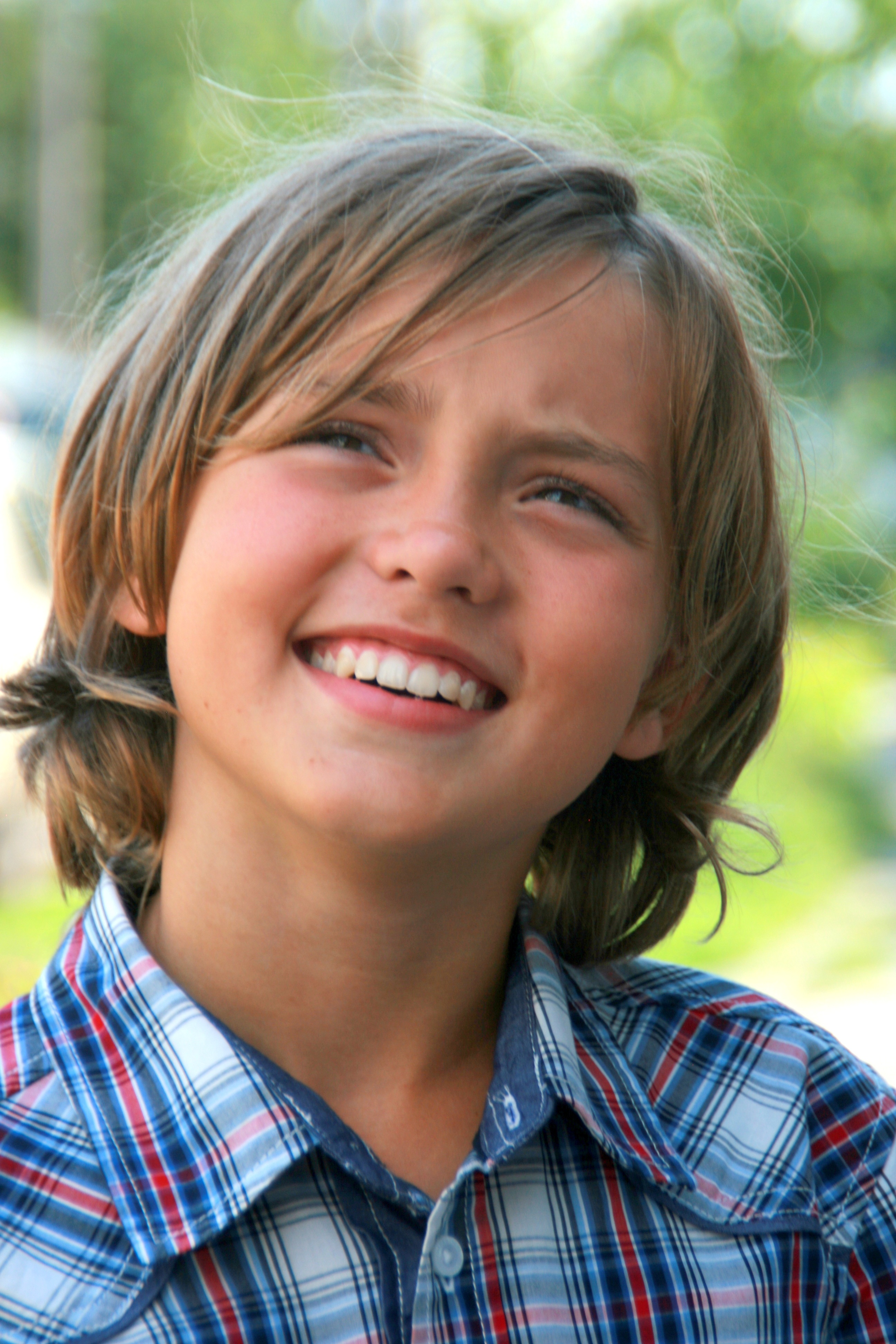 Portrait of a beautiful boy with an innocent expression on ...