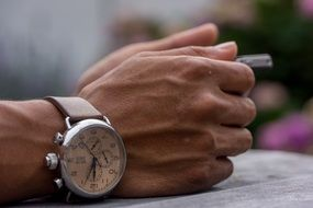 clock on male hands