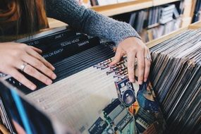 Girl in the choice of vinyl records