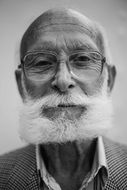 old man with beard in black and white