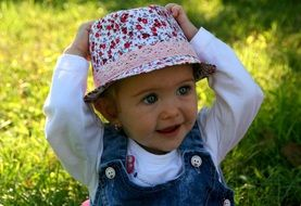 girl baby blue eyes hats grass
