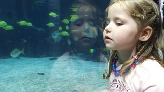 girl child fish reflection