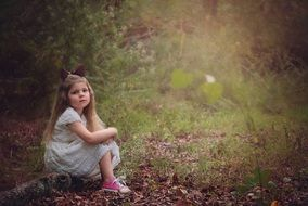 girl child woods portrait sitting