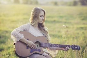 young woman play country guitar