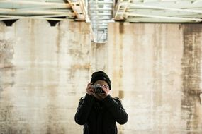 photographer in black hat