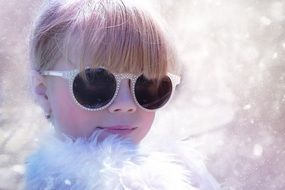 blond girl child in the snow