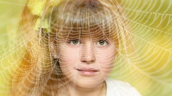 human child girl portrait blond face view cobweb