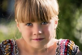 close portrait of a blond girl child