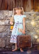 a child with suitcase