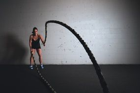 girl is training with ropes
