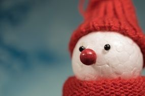 toy snowman with red cap and scarf