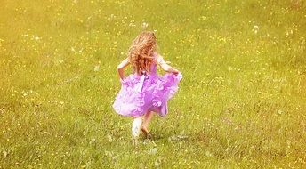 child running in the meadow