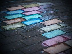 child painted paving tiles with chalk