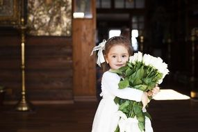 young girl with flowers bouquet