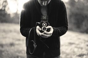 black and white photo of a photographer among nature