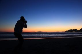 photographer snapping sunset