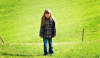 girl child with long hair in the meadow