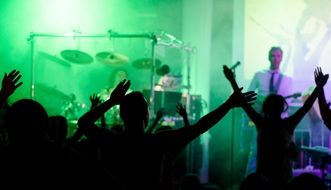 crowd cheering music band in the nightclub
