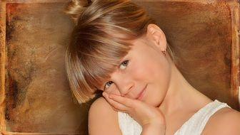 view of child girl face blond hair
