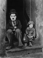Black and white photo of charlie chaplin and girl