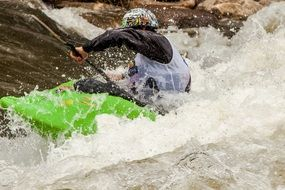 a man in a kayak goes down the cascade river